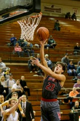 Yanni Karlaftis scored 24 points to go with 20 rebounds in West Lafayette's win over Covington.