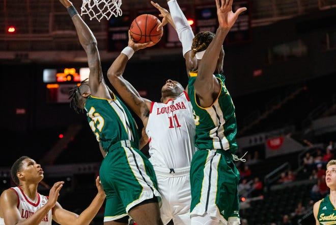 UL's Tirus Smith (11) works under the basket against Southeastern Louisiana earlier this season.