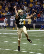 Acadiana kicker Drew Alleman celebrates after kicking a field goal to win the championship game against Sulphur on Saturday, Dec. 9, 2006.