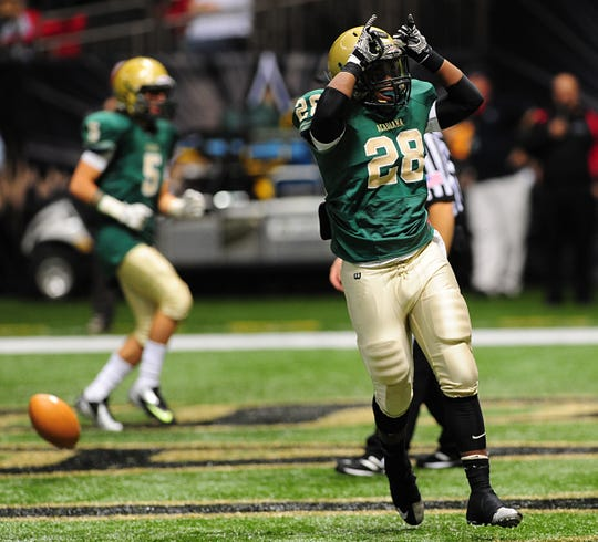 Acadiana running back Donovan Soloman (28) makes ram horns with his hands to celebrate a rushing touchdown during the Rams' 77-41 win over Parkway to win the Class 5A state title Saturday in the Mercedes-Benz Superdome on Dec. 14, 2013.