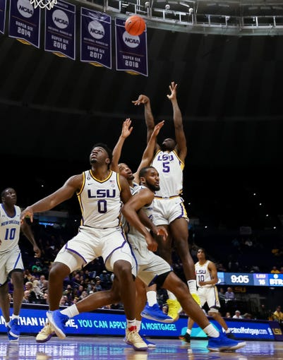 Dec 3, 2019; Baton Rouge, LA, USA;  LSU Tigers forward Emmitt Williams (5) shoots as jump shot against New Orleans Privateers during the first half at Maravich Assembly Center. Mandatory Credit: Stephen Lew-USA TODAY Sports