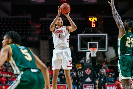 UL's Jalen Johnson shoots a 3-pointer Tuesday as the Ragin' Cajuns take on the Southeastern Louisiana Lions at the Cajundome.