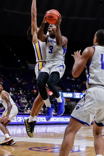 Dec 3, 2019; Baton Rouge, LA, USA; New Orleans Privateers guard Troy Green (3) drives to the basket against LSU Tigers forward Trendon Watford (2) during the second period at Maravich Assembly Center. Mandatory Credit: Stephen Lew-USA TODAY Sports