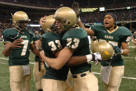 Acadiana's Drew Alleman (23) hugs teammate John Dean (33) after kicking the winning field goal in Saturday's Class 5A state championship game at the Superdome in New Orleans.