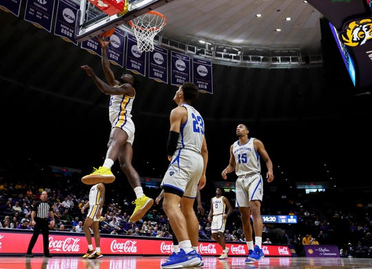 Dec 3, 2019; Baton Rouge, LA, USA;  LSU Tigers forward Emmitt Williams (5) shoots a lay up against New Orleans Privateers guard Ahren Freeman (23)during the first half at Maravich Assembly Center. Mandatory Credit: Stephen Lew-USA TODAY Sports