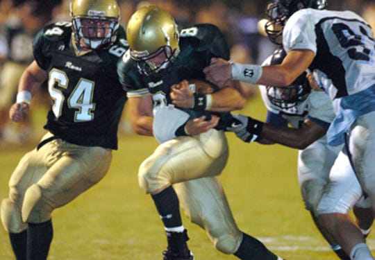 Acadiana High School's Johnathan Morvant (8) fights for yardage against Barbe during their game played Oct. 12, 2007, in high school football action at Acadiana High School in Scott.