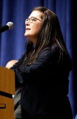 Dianne Garlinger, board president of Lancaster City Schools, speaks during the dedication ceremony for Thomas Ewing Junior High School Wednesday night, Dec. 4, 2019, in Lancaster.