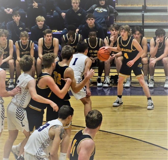 Lancaster sophomore guard Dylan West  dribbles the ball during the Golden Gales' game at Logan Tuesday night. Lancaster fell short, 50-47.