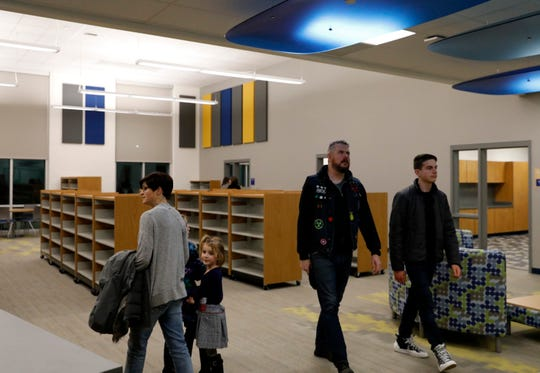 People tour the media center Wednesday, Dec. 4, 2019, at Thomas Ewing Junior High School in Lancaster.