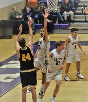 Lancaster's Jacob Davenport shoots the ball over a Logan defender during the Golden Gales' 50-47 loss Tuesday night.