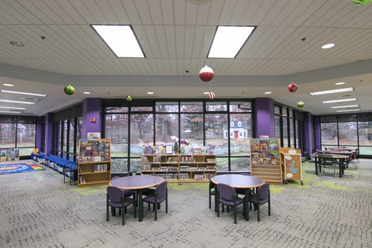 Brighton District Library's children's area, shown Wednesday, Dec. 4, 2019, has been reconfigured to maximize visibility to Millie's Garden in back of the library.