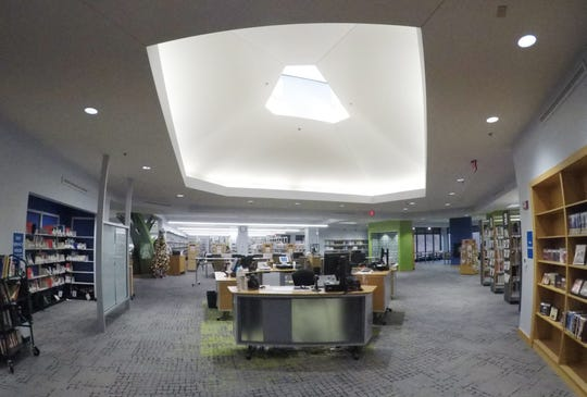 The service desk area of the Brighton District Library, shown Wednesday, Dec. 4, 2019, was custom-designed to mimic the shape of the existing skylight  and to facilitate serving patrons. The desks are mobile, allowing them to be moved aside for special events.