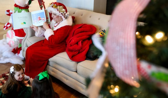 Mrs. Claus, Julie Engelhardt, reads to children as part of the Holidays in Hamburg in Lexington, KY on Dec. 1, 2019.