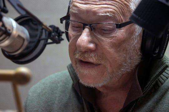 Barry Bernson reads during a recording session at the American Printing House for the Blind in November.