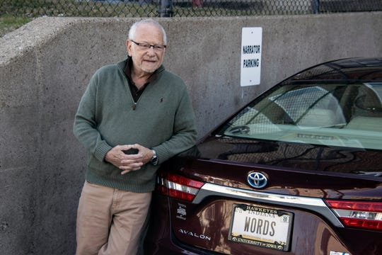 """With a personalized plate that reads WORDS and a """"narrator parking"""" space, Barry Bernson arrives for a recording session at the American Printing House for the Blind."""