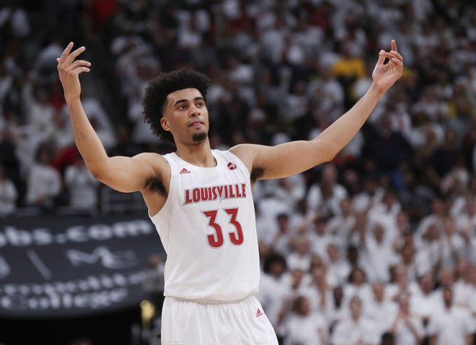 Louisville F Jordan Nwora (33) pumped up the crowd during the last seconds of their 58-43 win against No. 4 Michigan in Louisville, Ky. on Dec. 3, 2019.  It was their first game after receiving the number 1 ranking.