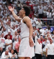 Louisville F Jordan Nwora (33) pumped up the crowd after he was able to hit a tough shot while being fouled by Michigan C Jon Teske (15) and got to the free throw line in Louisville, Ky. on Dec. 3, 2019.
