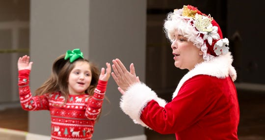 Mrs. Claus, Julie Engelhardt, leads a group of in a Christmas themed hokey pokey as part of the Holidays in Hamburg in Lexington, KY on Dec. 1, 2019.