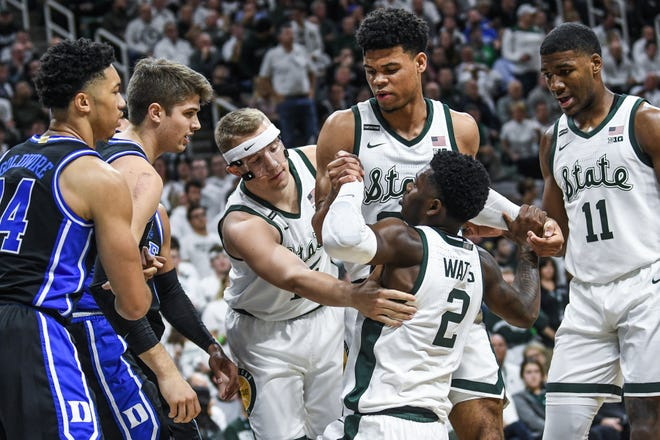 Michigan State's Rocket Watts (2) and Duke's Joey Baker have words after Baker fouled Watts on a drive to the basket during last year's game on Dec. 3 in East Lansing, won by the Blue Devils.