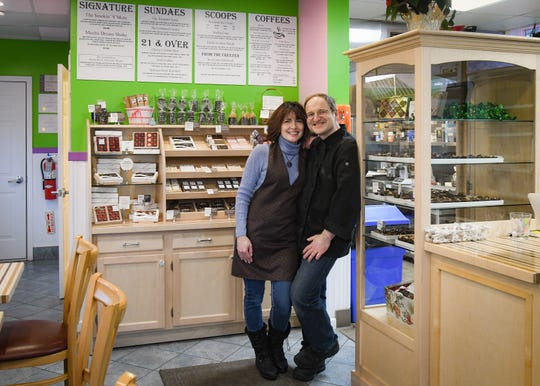 Park Lake Creamery co-owners Nikki and Konstantin Zsigo, pictured Wednesday, Dec. 4, 2019, in their specialty coffee, ice cream, and specialty dessert shop on Park Lake in Bath.