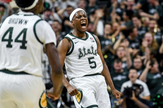 Michigan State's Cassius Winston celebrates after making a 3-pointer during the second half on Tuesday, Dec. 3, 2019, at the Breslin Center in East Lansing. The Spartans lost to the Blue Devils 87-75.