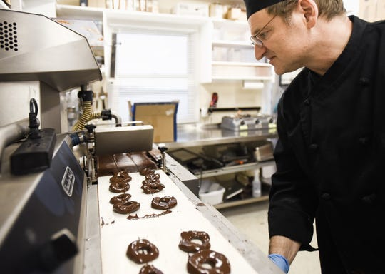 Park Lake Creamery co-owner and chocolatier Konstantin Zsigo works in his kitchen Wednesday, Dec. 4, 2019.