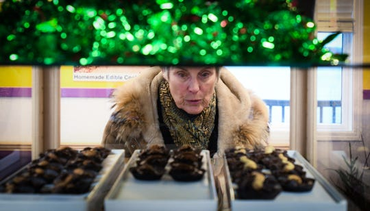 A woman peruses specialty chocolates, Wednesday, Dec. 4, 2019, at Park Lake Creamery in Bath.