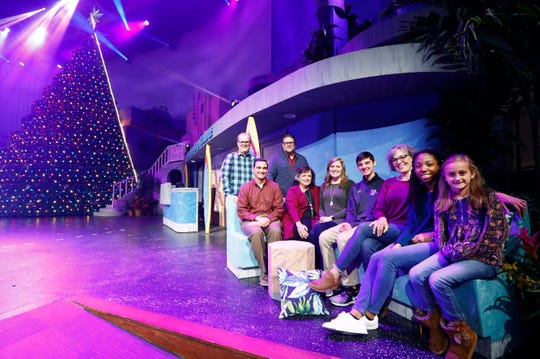 Cast and crew members Mark Blair, from rear, Mark Alexander and Hayden Simons, from left, Lisa Parker, Lauren Gooden, Lane Pyron, Kathryn Mayo, Muahn Yogar and Avery Simmons of the Bellevue Baptist Church's Singing Christmas Tree production pose on stage Wednesday, Dec. 4, 2019.