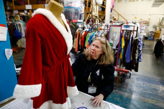 Paula Greene, director of costuming, works with a team of volunteers to cloth the more than 200 performers for Bellevue Baptist Church's Singing Christmas Tree performance.