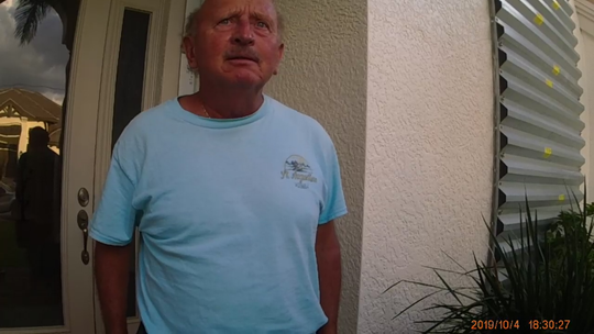 Roger M. Fleming is the only suspect in the case where someone put mothballs into an owl burrow in a Marco Island empty lot on Oct. 3 and Oct. 4 of 2019, according to a Florida Fish and Wildlife Conservation Commission (FWC) incident summary report. This image is a snapshot of the body camera footage of a FWC officer who visited Fleming for questioning on Oct. 4 and it shows Fleming standing in front of his Marco home.