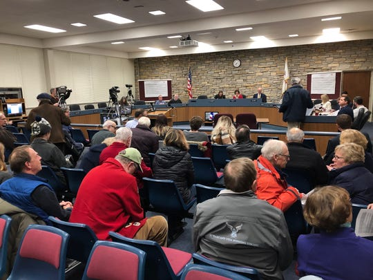 About 30 supporters of the Sanctuary Woods came to the Wauwatosa Common Council meeting on Dec. 3 to see the council approve the change in zoning that sets the woods aside as conservancy.
