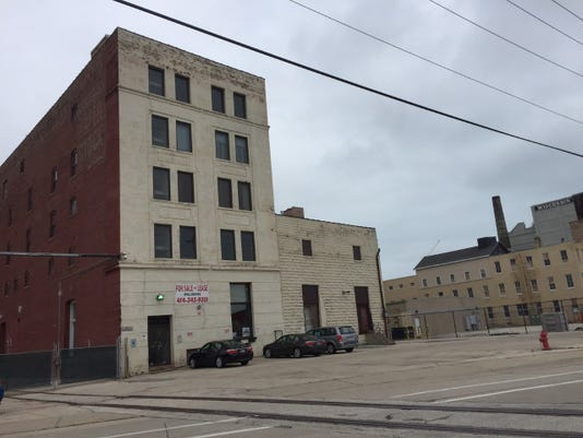 A former industrial building at 214 E. Florida St., shown in this 2018 photo, has been redeveloped and is to open soon as the Maxwell Lofts apartments.