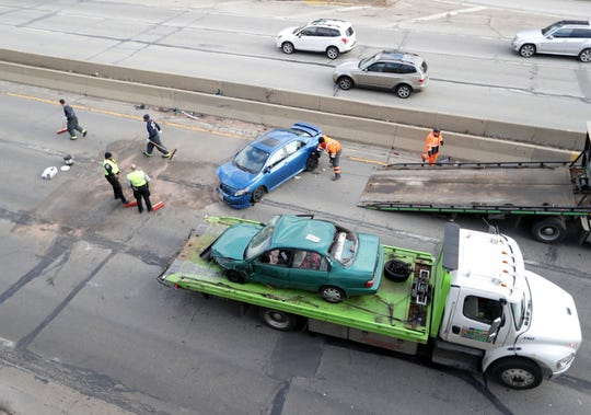 Work is done on the scene of a car accident on I-43 southbound just south of Capitol Drive in Milwaukee on Wednesday, Dec. 4, 2019.
