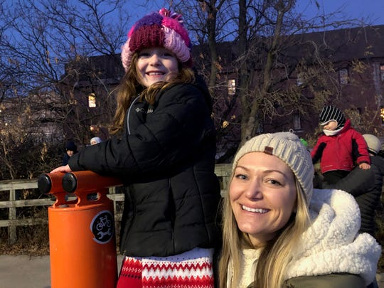 It was Deirdre (right) and Mila Carlisle's first time seeing the Holiday Train in Wauwatosa. Their favorite part was singing along to the Christmas songs.