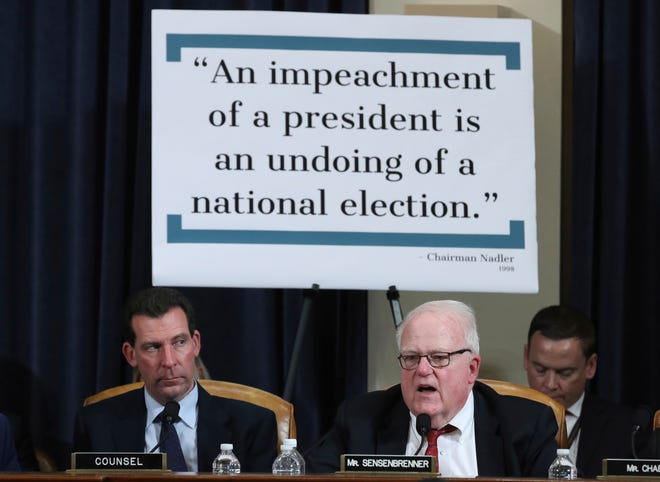 Rep. James Sensenbrenner, R-Wis., questions constitutional scholars during a hearing before the House Judiciary Committee on the constitutional grounds for the impeachment of President Donald Trump, on Capitol Hill in Washington, Wednesday, Dec. 4, 2019.  At left is staff attorney Paul Taylor.