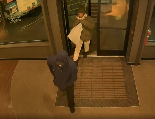 Greenfield police released this surveillance image of two men suspected of robbing two cellphone stores on Nov. 30 and Dec. 1. Police are asking for the public's help in identifying them.