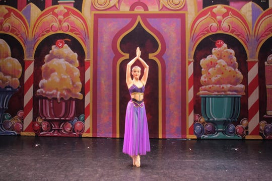"""Jaehee Ashley dancing the role of """"Arabian"""" in Act II, """"Land of the Sweets"""" in """"The Nutcracker""""."""