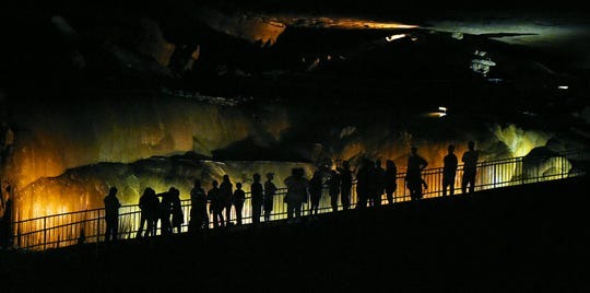 Tourists look over Cathedral Caverns State Park in Woodville.