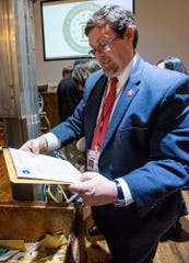 Alabama Archives and History Director Steve Murray holds a letter pulled from the time capsule, that was sealed during Montgomery's 150th anniversary in 1969 with instructions not to open it until the city's 200th anniversary, at City Hall in Montgomery, Ala., on Tuesday, December 3, 2019.