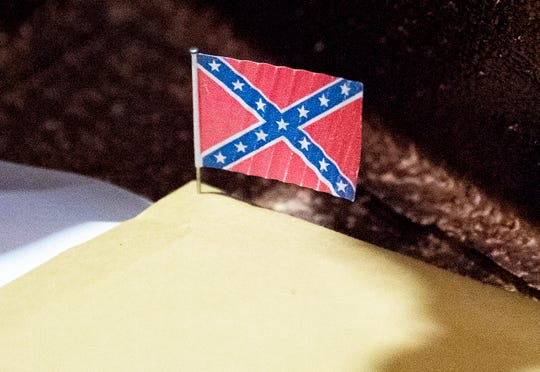 A small Confederate battle flag on a pin was in the time capsule.