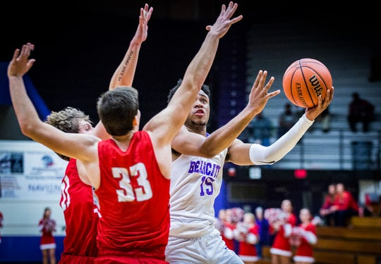Central's Victor Young fights for a shot past Fishers' defense during their game at the Muncie Fieldhouse Tuesday, Dec. 3, 2019.