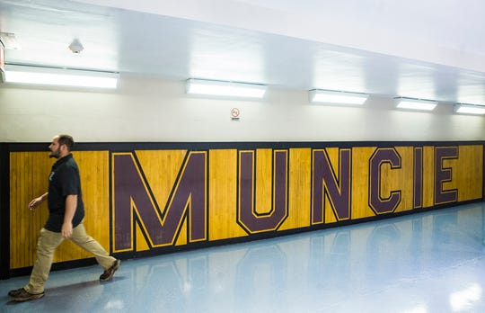 Portions of the old Muncie Fieldhouse floor that were damaged in a 2017 storm have been preserved and are now displayed in the corridors of the historic gym.