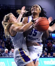 MTSU forward Charity Savage (35) goes up for a shot as Lipscomb guard Casey Collier (24) guards her on Wednesday, Dec. 4, 2019, at MTSU.