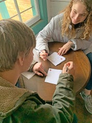 Children of all ages enjoy writing letters to Santa in the restored Jingo Post Office in the Historic Village in Fairview on Nov. 30, 2019.