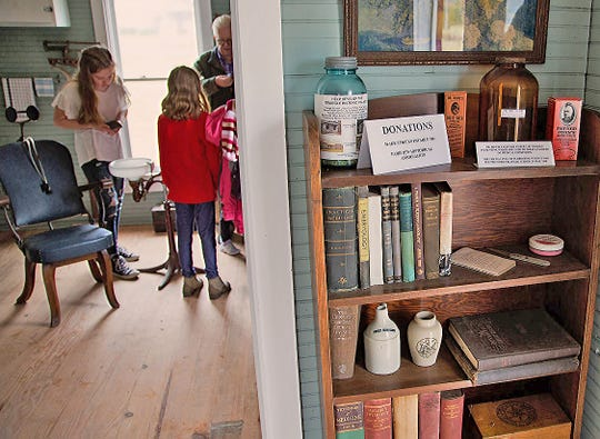 Children enjoyed seeing the antique antique examination chair and dental equipment at the Boone Street Clinic in Fairview's Historic Village on Nov. 30, 2019.