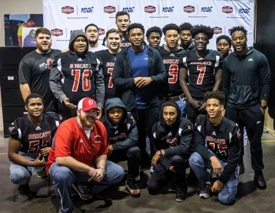 Kevin Byard of the Titans is photographed with the Overton High School football team at The Bridge Ministry Tuesday, December 3, 2019.