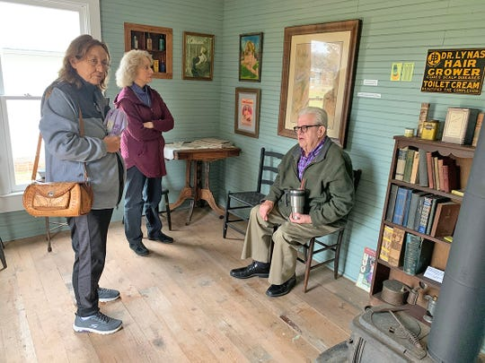 Dr. Neil Rice shares the History of the Boone Street Clinic with ladies visiting the Historic Village on Nov. 30, 2019.