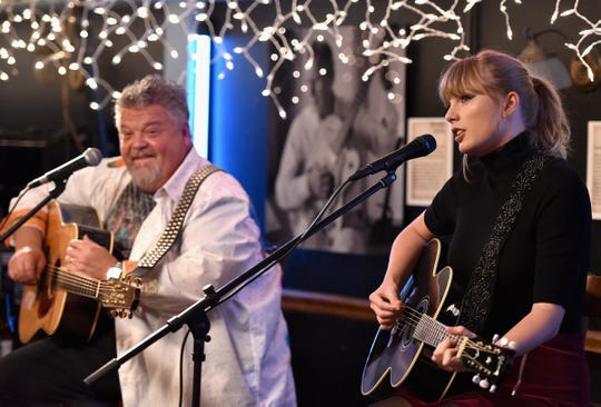 Craig Wiseman and special guest Taylor Swift perform onstage at the Bluebird Cafe on March 31, 2018.