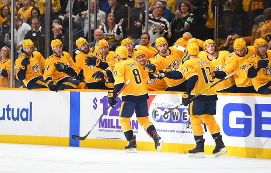 Nashville Predators center Kyle Turris (8) celebrates with teammates after a goal during the third period Dec. 3, 2019 against the Tampa Bay Lightning at Bridgestone Arena.