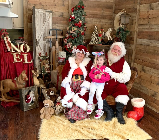 Children visited and had their photo made with Mr. and Mrs. Clause at the Triangle School in the Historic Village in Fairview on Nov. 30, 2019.